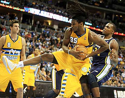 Denver forward Kenneth Faried snags a first-half rebound in the Nuggets' win over Utah on Friday. (US Presswire)
