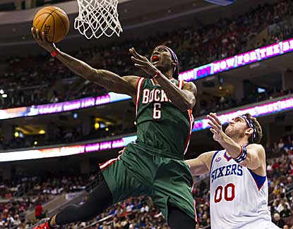 Milwaukee's Marquis Daniels goes up for two point past the 76ers' Spencer Hawes. (US Presswire)