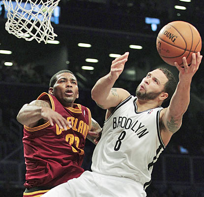 Deron Williams has a field day against the Cavs as he provides 26 points to go along with 10 assists. (AP)