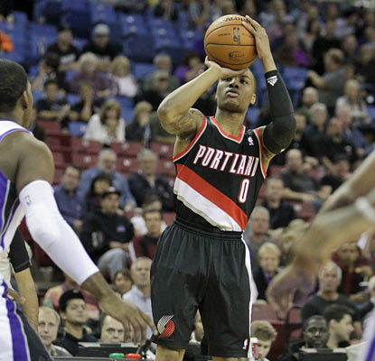 Rookie Damian Lillard finishes with 22 points and connects on 5 of 6 attempts beyond the arc. (AP)