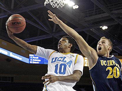 UCLA guard Larry Drew II drives past Irvine's Adam Folker for a layup in the first half. Drew later scores the winning layup.  (AP)
