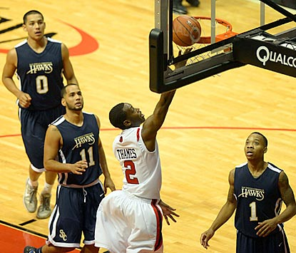 Hawks defenders can only watch as Aztecs guard Xavier Thames scores on a layup in the second half.  (US Presswire)