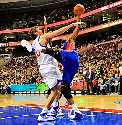 Greg Monroe (right), who scores 19 points and grabs 18 boards, fights for the ball with 76ers center Spencer Hawes. (US Presswire)