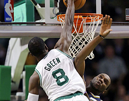 Boston forward Jeff Green jams in the face of the Jazz's Al Jefferson for 2 of his 16 points. (US Presswire)