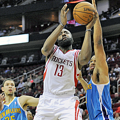 James Harden goes up for two of his 30 points in the Rockets' four-point win over the Hornets. (AP)
