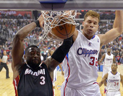 The Clippers' Blake Griffin dunks on Miami's Dwyane Wade. Griffin scores 20 points and grabs 14 rebounds. (AP)