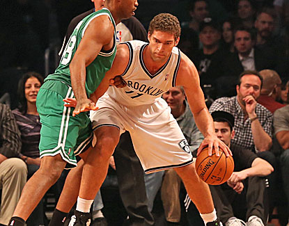 Brooklyn big man Brook Lopez scores 24 points against the Celtics, one of four Nets players to score in double figures. (US Presswire)