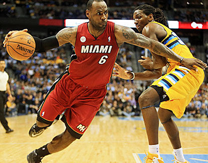 LeBron James dominates, even without his headband, against the Nuggets on Thursday, going for 27 points and 12 assists. (US Presswire)
