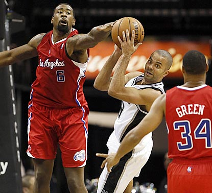 Tony Parker looks to pass after being stopped by DeAndre Jordan during the second half.  (US Presswire)
