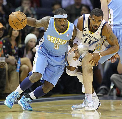 Denver point guard Ty Lawson, with help from a teammate's pick, evades Memphis' Mike Conley Jr.  (US Presswire)