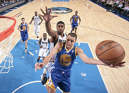 Stephen Curry goes in for a layup ahead of O.J. Mayo. After a rough start, Curry scores 20 of his team's final 32 points.  (Getty Images)
