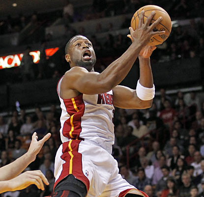 Dwyane Wade ties a game-high with 28 points on 11 of 21 shooting from the field as the Heat drop the Bucks. (AP)