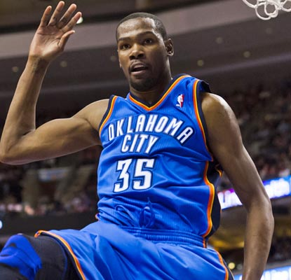 Kevin Durant does his thing, dropping 37 points on the 76ers, including the Thunder's first five in OT.  (US Presswire)