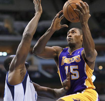 The Lakers' first road win of the season is a total team effort, and Metta World Peace chips in with 19 points.  (AP)