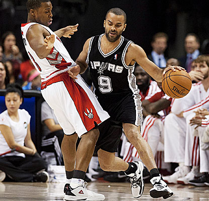 Tony Parker hits for six points of his 32 points in the second overtime as the Spurs hold off Toronto. (AP)
