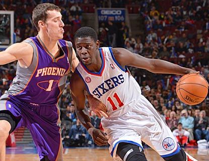 Jrue Holiday, driving here on Goran Dragic, has perhaps his best game as a pro and earns his fifth double-double of the season. (Getty Images)