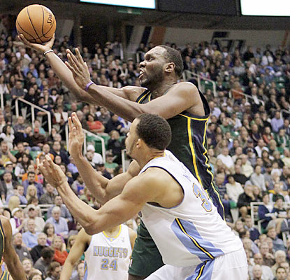 Al Jefferson (28 points) and the Jazz overcome a 16-point hole to survive the Nuggets and keep their perfect home mark intact. (AP)