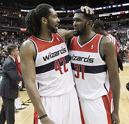 Nene and Chris Singleton can finally celebrate. After a 0-12 start, the Wizards are finally in the win column.  (AP)
