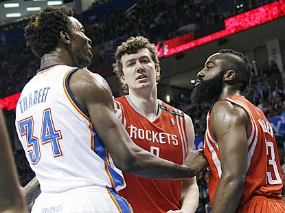 Omer Asik (center) diffuses some tension between Hasheem Thabeet (34) and James Harden, who were teammates briefly in the fall. (AP)