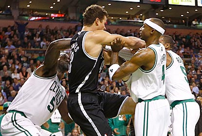 Kris Humphries (center) incurs the wrath of Rajon Rondo (far right) for his hard foul on Kevin Garnett (left).  (Getty Images)