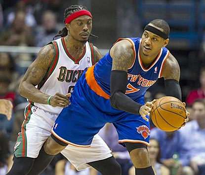 Carmelo Anthony, shown working against Marquis Daniels in the third quarter, helps New York build a lead as high as 22 points. (US Presswire)