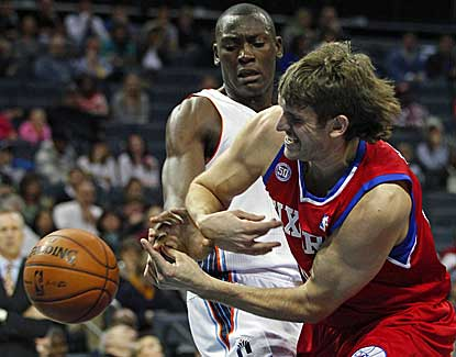 Charlotte's Bismack Biyombo, left, battles with the 76ers' Spencer Hawes on Friday night. (AP)