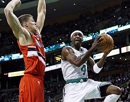 Celtics guard Jason Terry goes up for a shot as Portland's Meyers Leonard tries to swat it away. (AP)