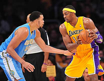 Lakers center Dwight Howard looks for an opening against Denver's JaVale McGee. (US Presswire)