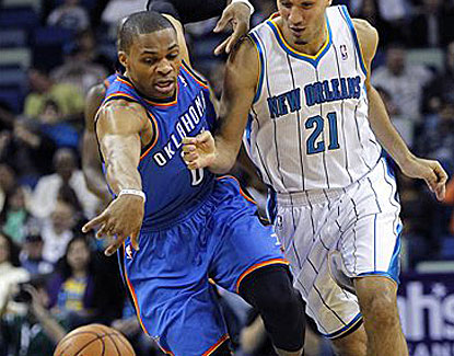 Russell Westbrook steals the ball from New Orleans guard Greivis Vasquez, one of three on the night for the OKC star. (AP)
