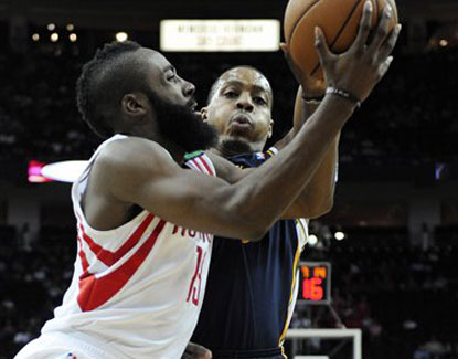 James Harden scores 18 points for the Rockets, who shoot 55 percent as a team in their win over Utah. (AP)