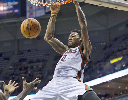 Larry Sanders jams home two of his 18 points against the Celtics. The Bucks big man also grabs 16 boards. (US Presswire)