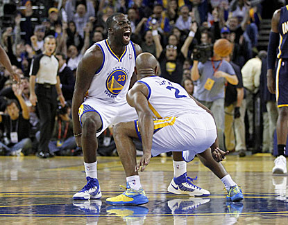 Warriors guard Jarrett Jack (2) celebrates with Draymond Green after making a half-court shot to end the 3rd quarter. (US Presswire)