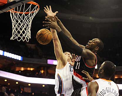 Blazers center J.J. Hickson battles for a rebound with Charlotte's Byron Mullens on Monday. (US Presswire)
