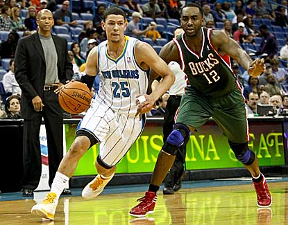 Hornets guard Austin Rivers drives past Milwaukee's Luc Richard Mbah a Moute on Monday. (US Presswire)
