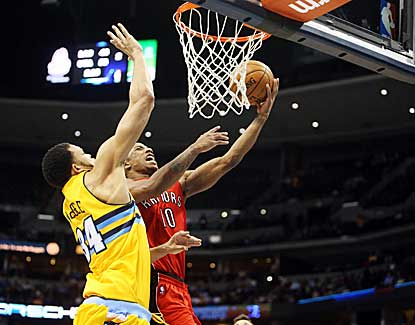 Toronto guard DeMar DeRozan drives for the layup against Denver's JaVale McGee. (US Presswire)