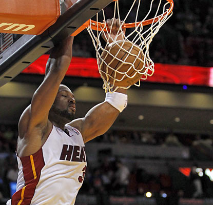 Dwyane Wade puts up 26 points on 11-of-13 shooting and also adds four rebounds and three assists in the win. (AP)