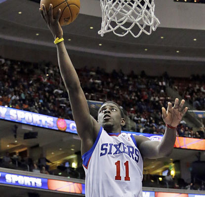Jrue Holiday (25 points, five boards, eight assists) is one of five Sixers to score in double figures. (AP)