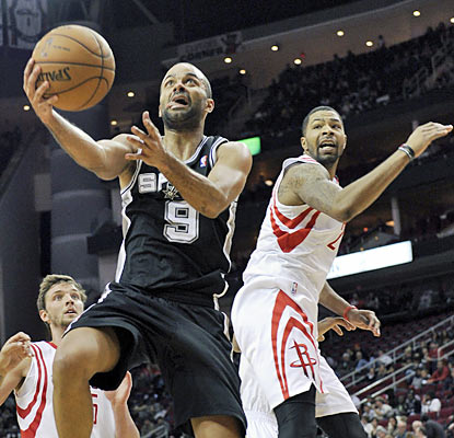 Tony Parker comes through with his first career triple-double as he finishes with 29 points, 12 assists and 12 rebounds. (AP)