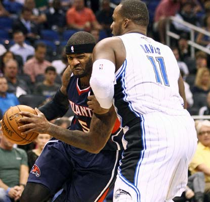 Josh Smith scores 16 for the balanced Hawks, who have won eight straight regular season games over the Magic.  (US Presswire)