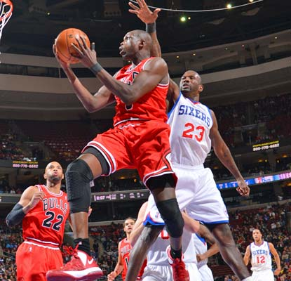 Luol Deng scores 19 points and grabs 12 rebounds and the short-handed Bulls pull out a big win in Philadelphia.  (Getty Images)