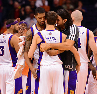 The Suns' Goran Dragic (center) gets love from his teammates after his game-winning shot. (US Presswire)