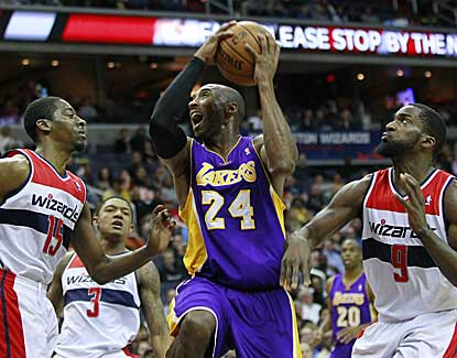 Kobe Bryant goes up for a shot against Jordan Crawford and Martell Webster. Bryant finished with 30 points. (US Presswire)