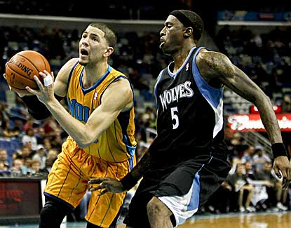 Hornets guard Austin Rivers drives past Minnesota forward Josh Howard on Friday night. (US Presswire)