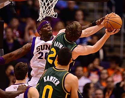 Phoenix center Jermaine O'Neal gets the block against Utah guard Gordon Heyward on Friday night. (US Presswire)