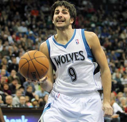 Ricky Rubio, in his first game in nine months, dishes out nine assists and scores eight points in Minnesota's win.  (US Presswire)