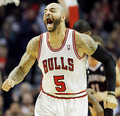Carlos Boozer (15 points) and the shorthanded Bulls get the job done against the Nets. (AP)
