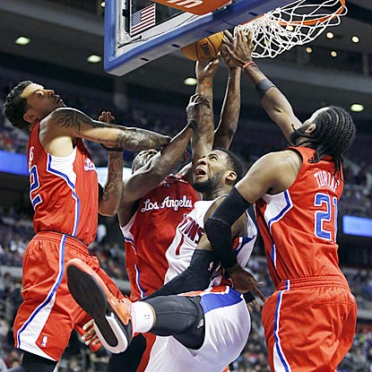 Pistons forward Andre Drummond (1) battles three Clippers, including Ronny Turiaf (right), for a rebound in the fourth quarter. (AP)