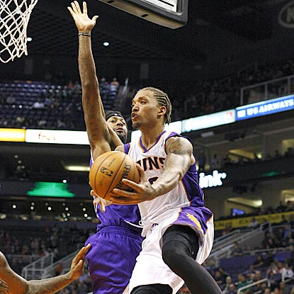 Phoenix's Michael Beasley drives past Sacramento's James Johnson while passing during the game-changing third quarter.  (AP)