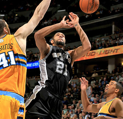 The Nuggets get past the Spurs despite Tim Duncan racking up 31 points, 18 rebounds, six assists and five blocks. (Getty Images)