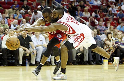 Philadelphia's Thaddeus Young and Houston's James Harden compete for a loose ball during the second quarter.  (US Presswire)